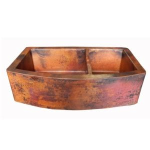 rounded apron front farmhouse kitchen copper sink