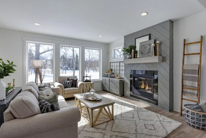 Modern Farmhouse Living Room with Shiplap Fireplace by CJC Interiors