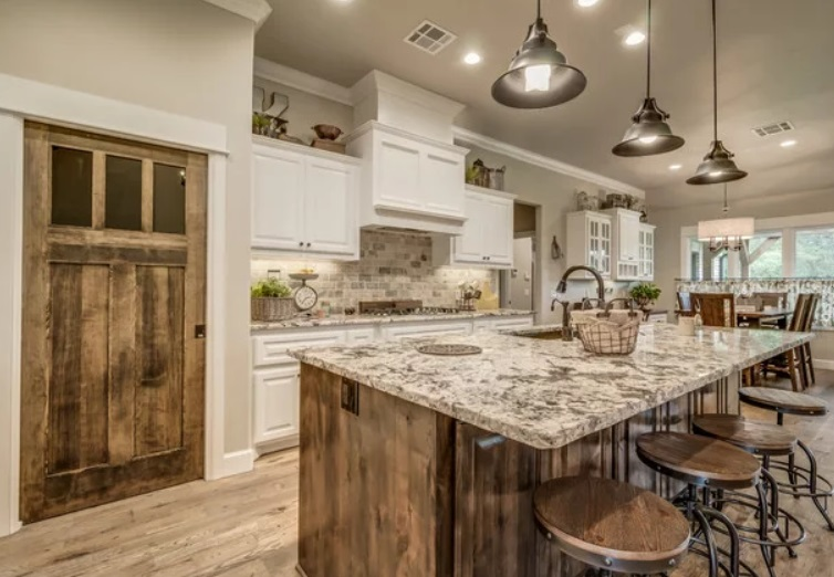 Yosemite Farmhouse Kitchen by Tray McCune Homes