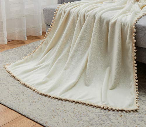 Janzaa Throw Blanket Cozy Flannel Blanket With Pompom Tassel Soft Microfiber Bed Blanket White Fuzzy Blanket For Couch 51x63Inches 0 2