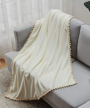 Janzaa Throw Blanket Cozy Flannel Blanket With Pompom Tassel Soft Microfiber Bed Blanket White Fuzzy Blanket For Couch 51x63Inches 0 3 300x360