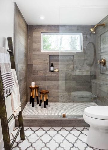 Luxury Farmhouse Bathroom by Juxtaposed Interiors