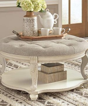 Signature Design By Ashley Realyn Upholstered Ottoman Cocktail Table W Fixed Shelf WhiteBrown 0 300x360