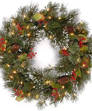 National Tree Company Pre Lit Artificial Christmas Wreath Flocked With Mixed Decorations And Pre Strung White LED Lights Wintry Pine 24 Inch 0 300x360
