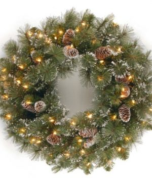 National Tree Company Pre Lit Artificial Christmas Wreath Flocked With Mixed Decorations And Pre Strung White Lights Glittery Pine 24 Inch 0 300x360